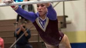 Bay Shore's Skye Harper performs on the uneven