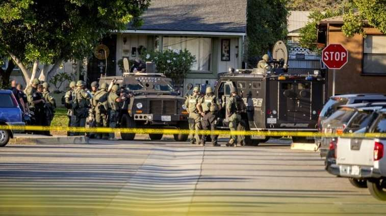 SWAT team moves in on a barricaded suspect