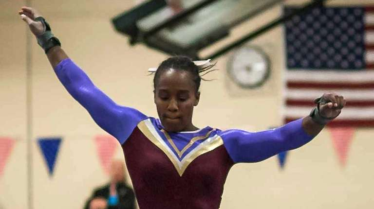Bay Shore's Hayden Davidson competes on the balance