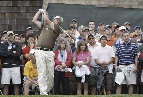 Phil Mickelson tees off on the third hole