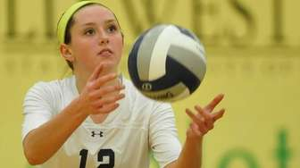 Shannon Brooks of Massapequa serves during the Nassau