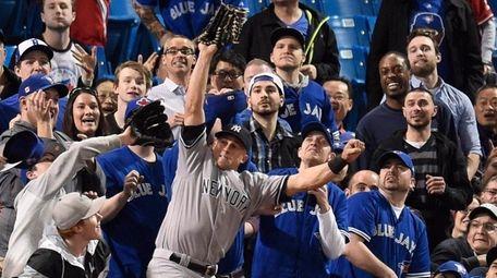 New York Yankees' Brett Gardner falls into the