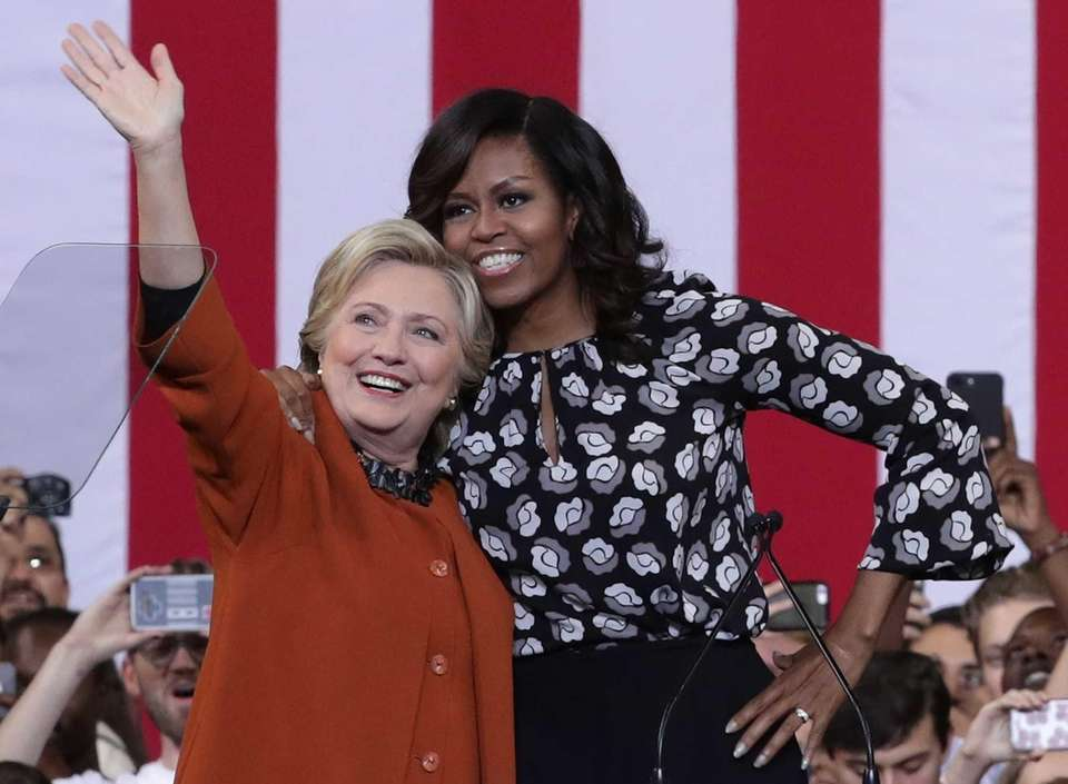 United States first lady Michelle Obama greets supporters