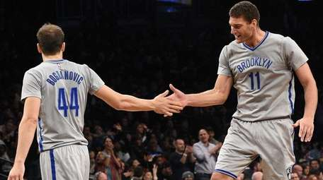 Brooklyn Nets center Brook Lopez congratulates Nets guard