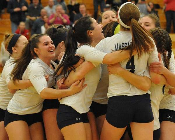 Massapequa volleyball players celebrate 3-0 win over Long