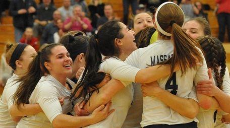 Massapequa volleyball players celebrate 3-0 win over Long