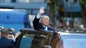 Donald Trump departs after voting at the Beckman