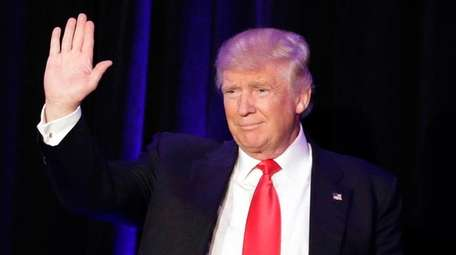 President-elect Donald Trump waves at the crowd at
