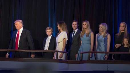President-elect Donald Trump followed by his family as