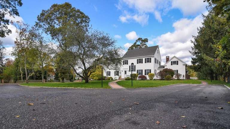 This three-story Colonial in Bayport features six bedrooms