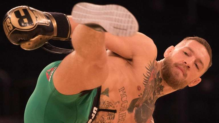 UFC featherweight champion Conor McGregor kicks during an