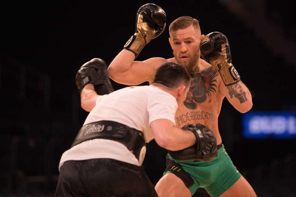 UFC featherweight champion Conor McGregor shows off during