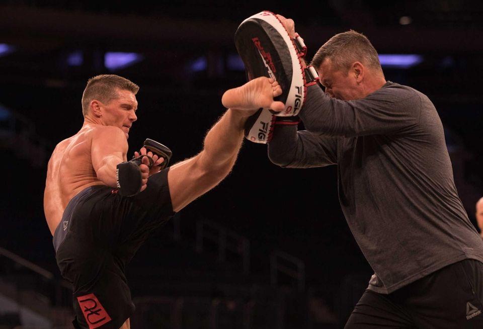 UFC welterweight Stephen Thompson kicks during an open