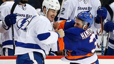 Travis Hamonic of the New York Islanders fights