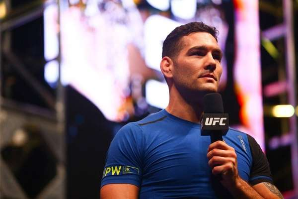 Chris Weidman takes questions from media after an