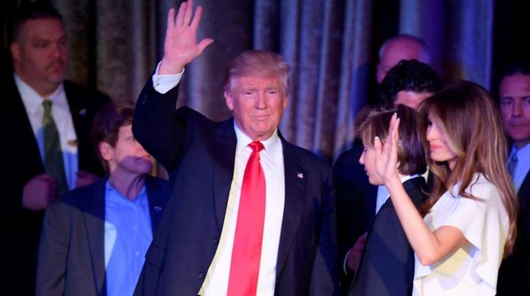 President-elect Donald Trump and wife Melania wave to