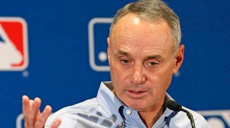 MLB Commissioner Rob Manfred answers a question as