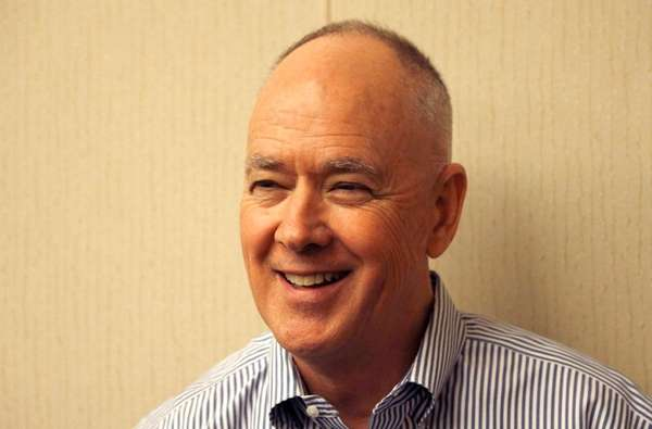 New York Mets' general manager Sandy Alderson smiles