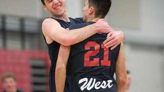 Smithtown West's David DeRosa (21) and Chris Shanley