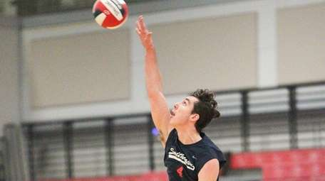 Smithtown West's Chris Shanley (4) serves in the
