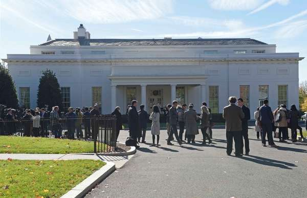 People gather outside the West Wing of the