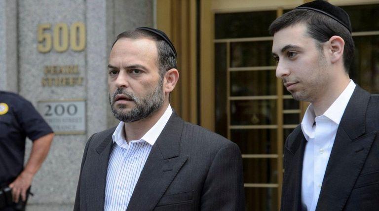 Alex Lichtenstein, center, exits a federal courthouse in