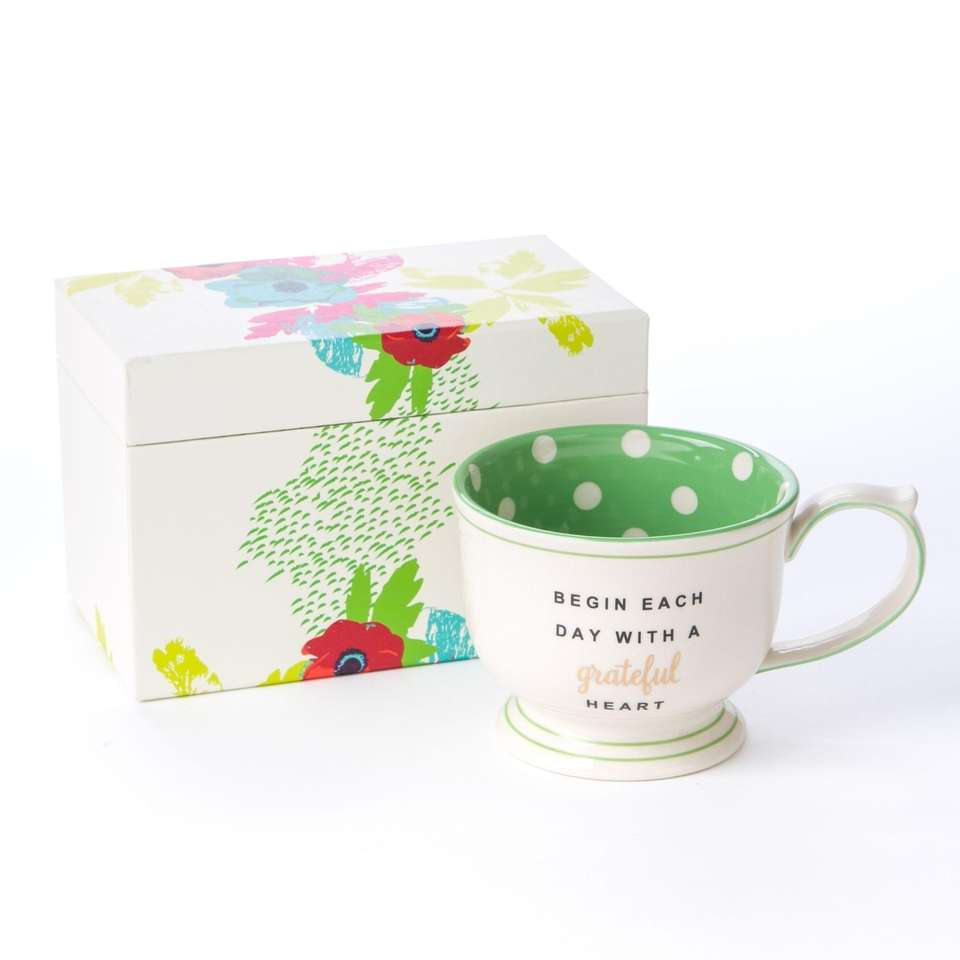This handmade mug features lime green polka-dots with
