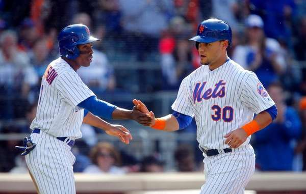 Michael Conforto and Curtis Granderson of the New