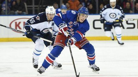 New York Rangers defenseman Brady Skjei skates ahead