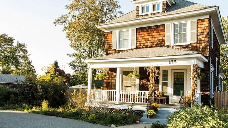 This restored circa-1920 Patchogue Colonial is listed for