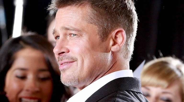 Brad Pitt attends a fan event for the