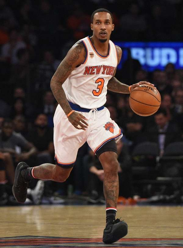 New York Knicks guard Brandon Jennings controls the