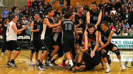Bellmore JFK players celebrate after beating Jericho in