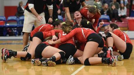 Connetquot players and coaches celebrate their win against