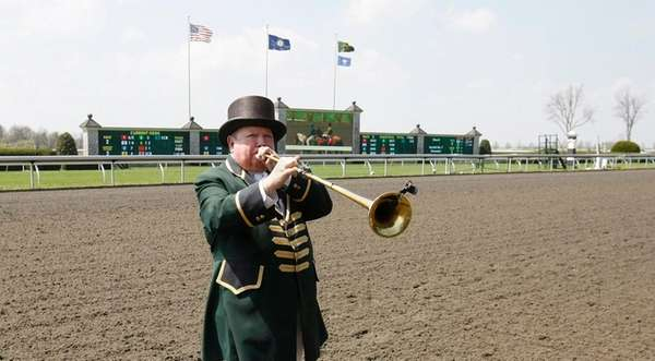 Bugler Bucky Sallee plays the call to the