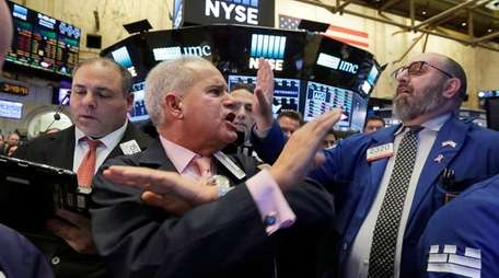 Traders call out prices for their organization Wednesday,
