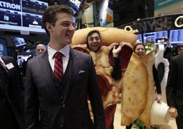 GrubHub Inc. CEO Matthew Maloney, trailed by costume