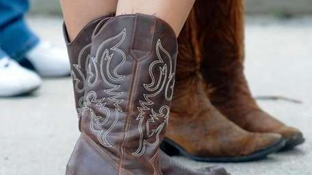 Cowboy boots are common before the Kenny CHesney