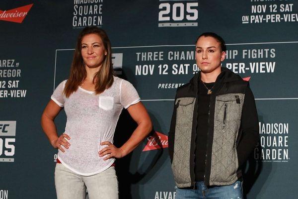 Miesha Tate, left,and Raquel Pennington pose for a