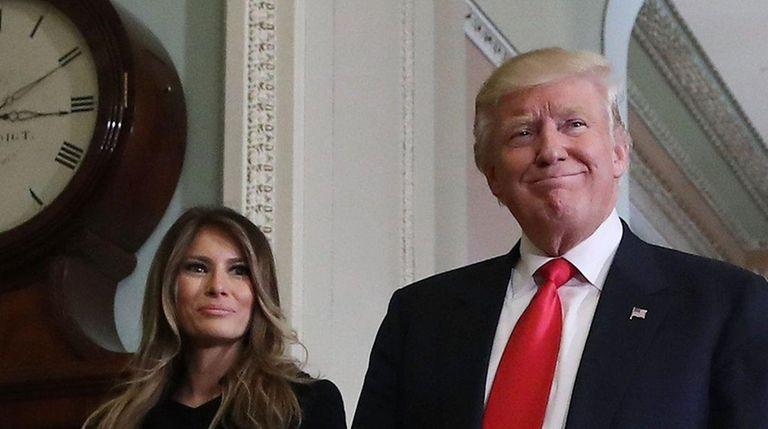 Melania Trump and President-elect Donald Trump walk from
