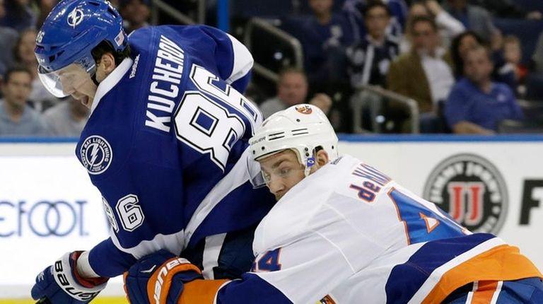 Tampa Bay Lightning's Nikita Kucherov gets held by