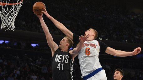 New York Knicks' forward Kristaps Porzingis blocks a