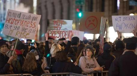 People march through Manhattan to Trump Tower during