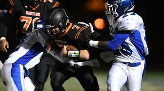 Bablyon's Scott Sasso (7) carries the ball while