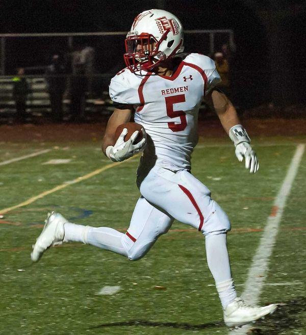 East Islip's Justin Taveras (5) scores a touchdown