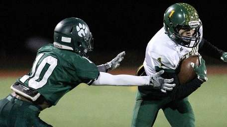 Ward Melville's John Corpac (1) makes a catch