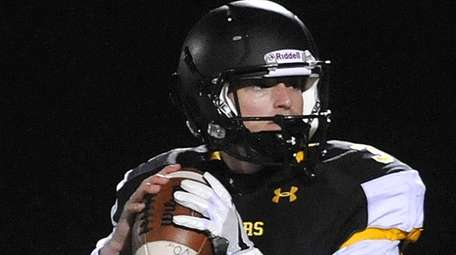 St. Anthony's quarterback Bo Waters looks for a