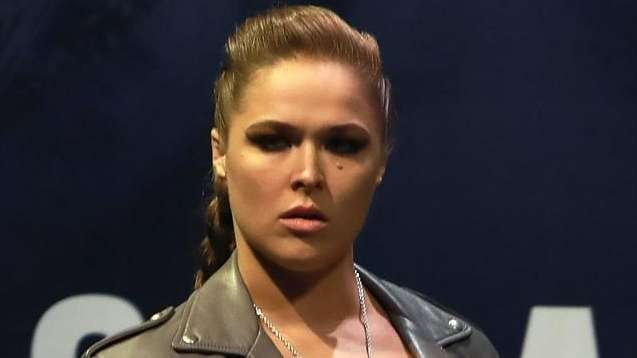 Ronda Rousey walks on stage for her face