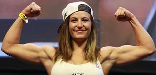 Miesha Tate reacts during UFC 205 weigh-ins at