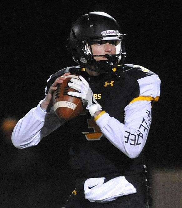 St. Anthony's quarterback Bo Waters #3 looks for